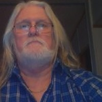 long haired country boy's photo